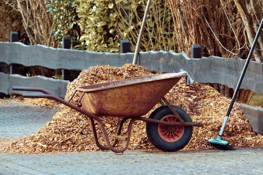 wheel barrow getting ready for the mulching of a garden bed.